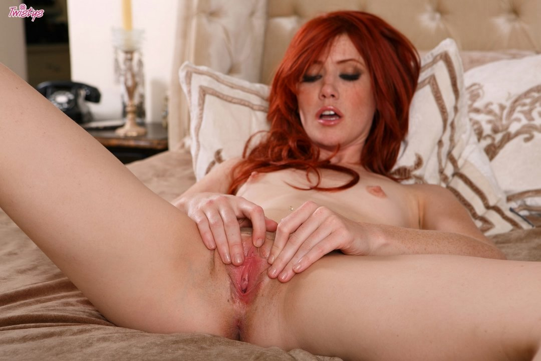 Hot redhead Elle Alexandra fucks her pussy with a toy ...